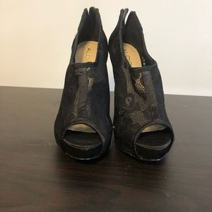 ALDO Keasley black lace back zippered platforms.